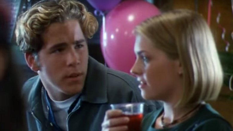 "Ryan Reynolds and Melissa Joan Hart in the ""Sabrina the Teenage Witch"" TV movie"