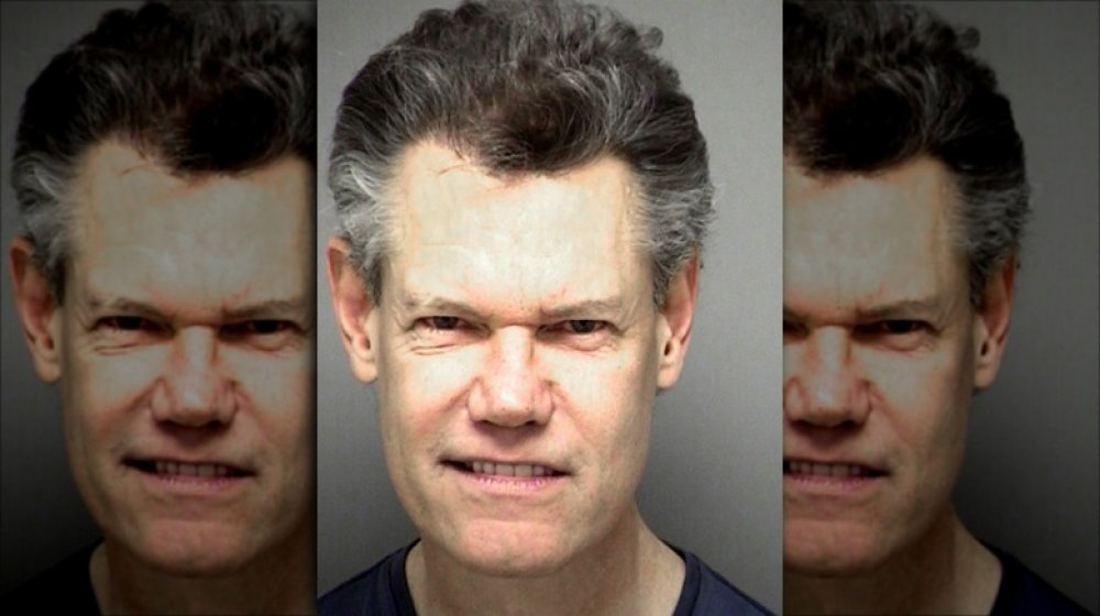 Randy Travis, after naked car crash, sues to keep video