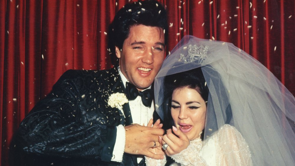 Elvis Presley and Priscilla Presley have rice thrown at them on their wedding day