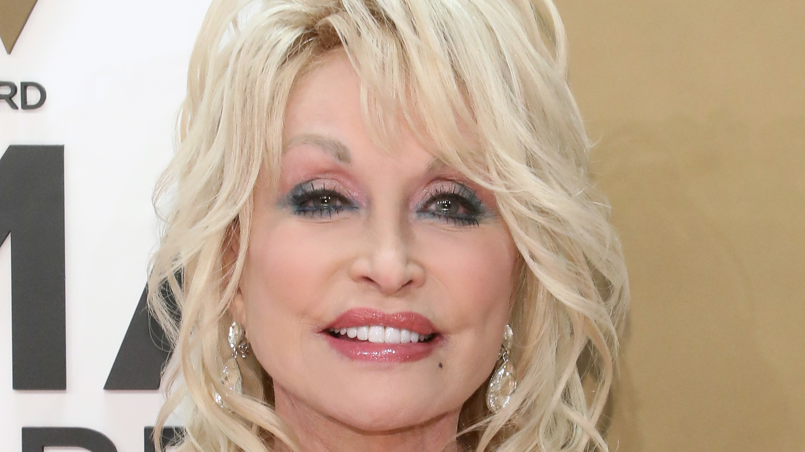 The Real Reason Dolly Parton Is Calling People 'Cowards'.jpg