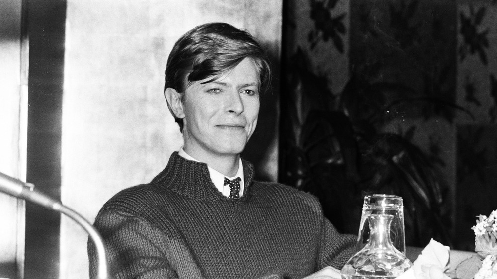 David Bowie at a hotel and smiling