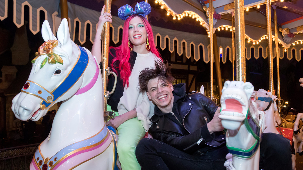 Halsey and Yungblud laughing on a carousel