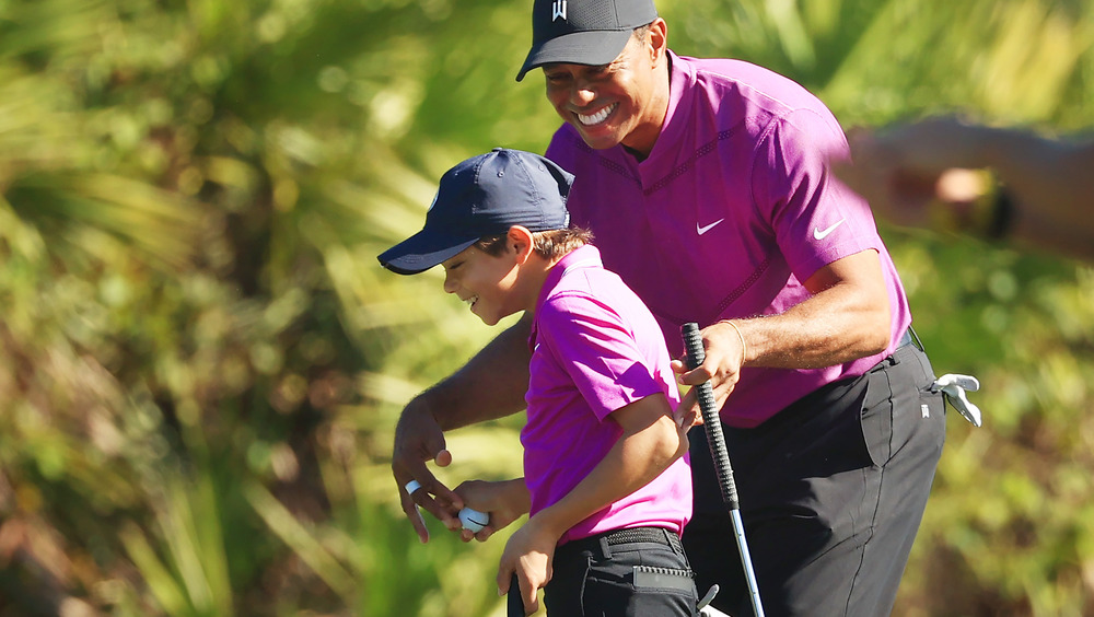 Charlie Woods and Tiger Woods smiling