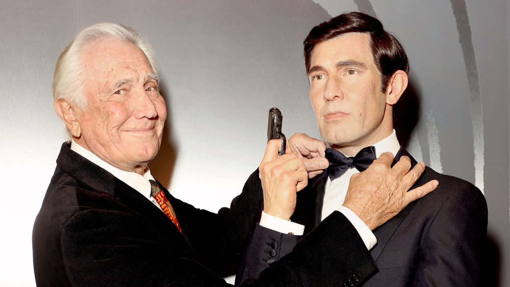 George Lazenby poses with his James Bond waxwork
