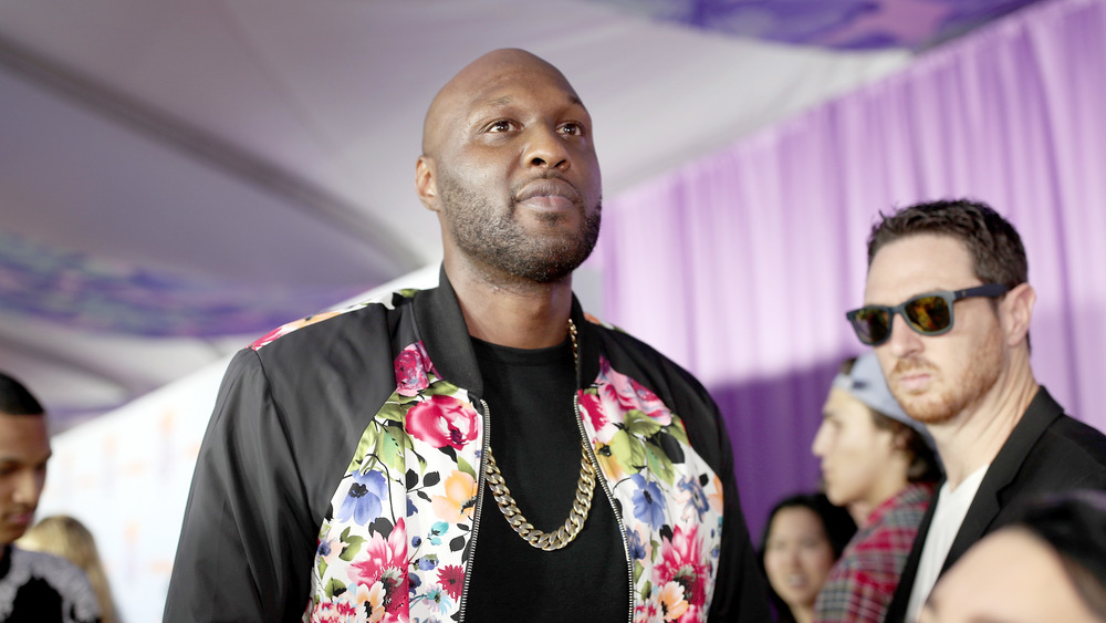 Lamar Odom lost in thought, walking red carpet