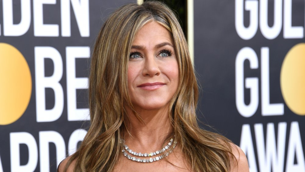Jennifer Aniston smiling and looking up at the 2020 Golden Globe Awards