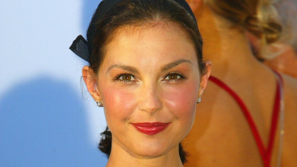 Ashley Judd with her hair pulled back, smiling a soft smile while looking straight at the camera
