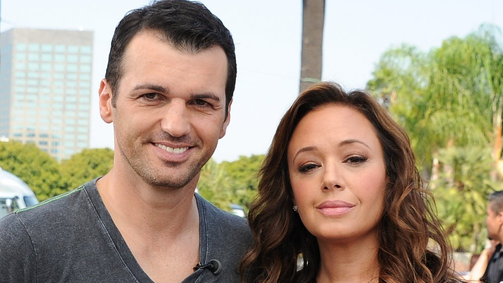 Tony Dovolani and Leah Remini on Extra in 2013