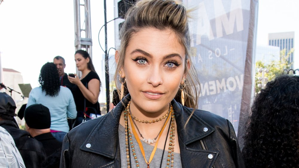 Paris Jackson with hair pulled back in ponytail