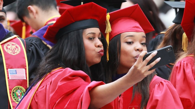 Two USC students at graduation